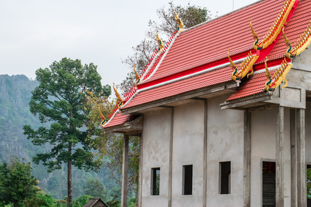 The Thai temple is at the foot of the hill.