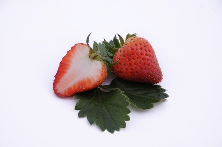 Fresh ripe strawberries with leaves, isolated on white with soft shadow Stock Photo - 12974611