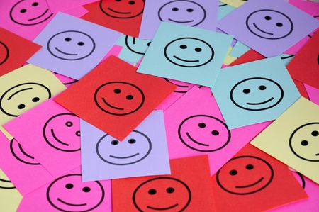 Pile of colorful paper notes with smilling face symbols  photo