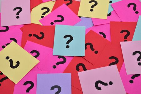 Pile of colorful paper notes with question marks photo