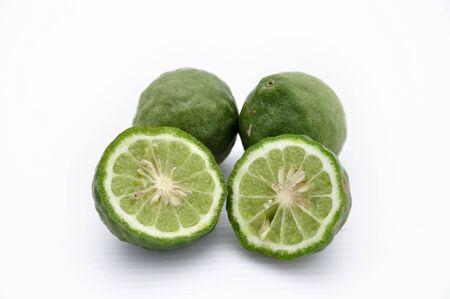 Kaffir limes on white background