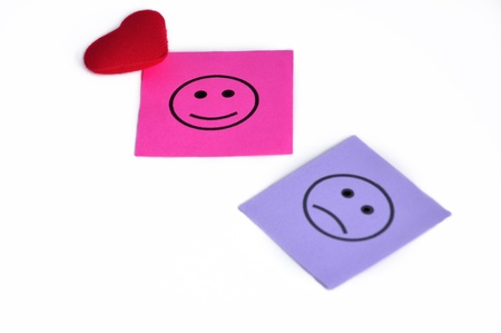 Paper notes with happy and sad faces Stock Photo - 13056441