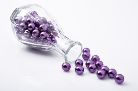 seed beads: Purple beadl in the glass bottle Stock Photo