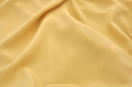 Gold Smooth Satin Background with shine  Stock Photo - 13092767