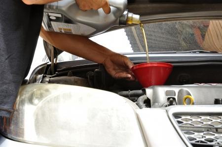 Car mechanic : engine oil change  photo