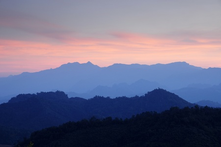 Horizontal photo of sunsets over mountains photo