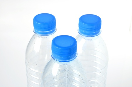 Empty plastic water bottle on a white background