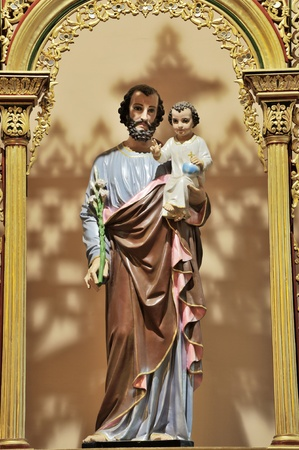 Baby Jesus and his father Joseph photo