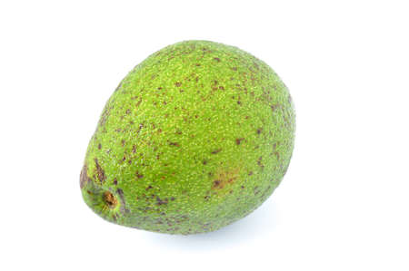 Green avocado on a white background.  Stock Photo