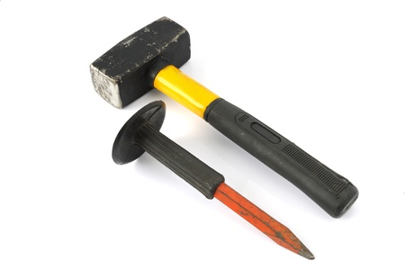 Hammer and chisel on a white background  photo