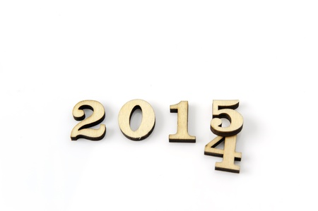Change 2014 figures to 2015 are made of wood on a white background  Stock Photo