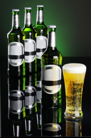 Bottle of Beer with full beer of glass