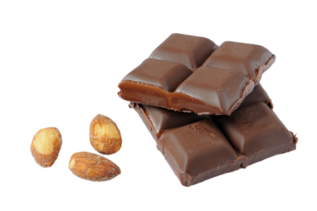 Pieces of Dark chocolate with almonds on a white background