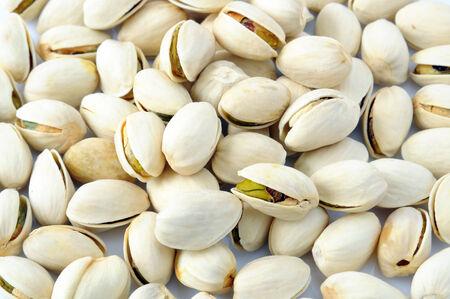 Pistachios nut on a white