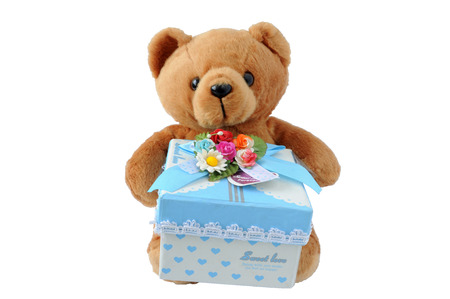 Teddy bear holding a gift on white  Stock Photo