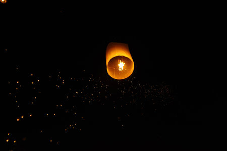 Lanterns floating on the sky in Loi Krathong Traditional Festival  Stock Photo