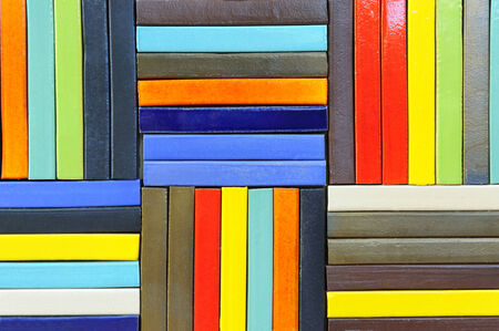multicolored: Multi-colored cement sheets arranged into a wall. Stock Photo