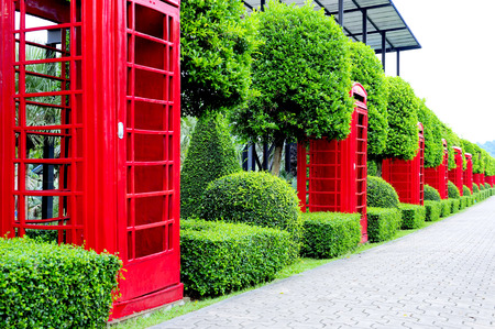 A row of red phone box decorative garden.