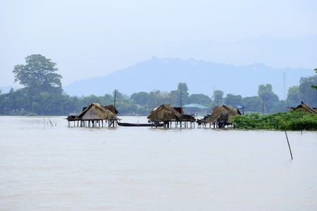 Peaceful scenes of rural people live in huts built on the water. Stock Photo
