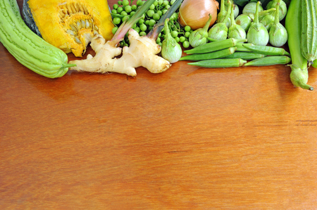 Healthy fresh vegetables on wood background