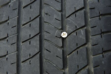 prick: Flat tire because the screw prick tire. Stock Photo