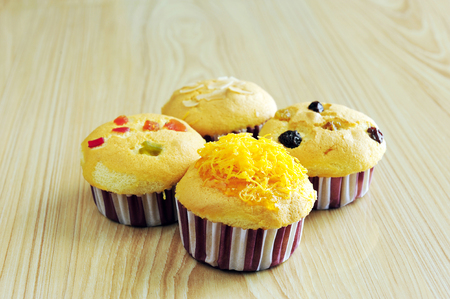 Golden cupcake and variety topping