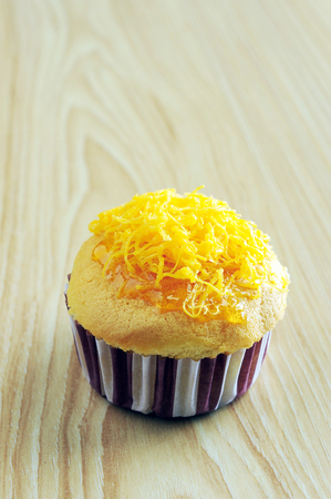 Golden cupcake and topping
