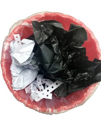 Red wastepaper basket in office