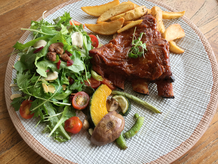 Pork ribs barbecued steak with vegetable salad Stock Photo