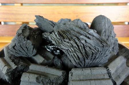 The burned wood becomes black charcoal for fuel.