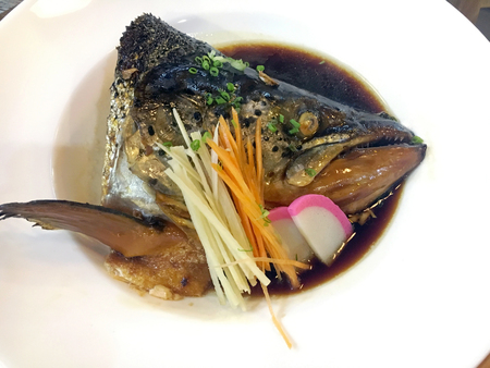 Steamed salmon head with soy sauce Stock Photo