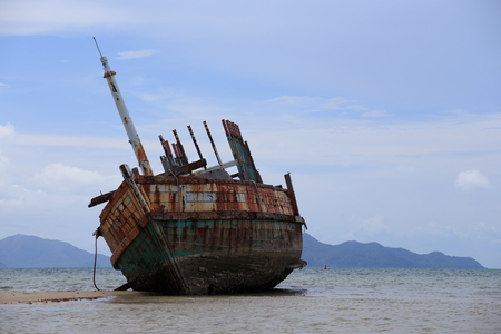 beached: Abandoned ship with blue sky Stock Photo