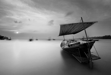 The fishing boat at Kon Ao Beach in black and white, Rayong, Thailand photo