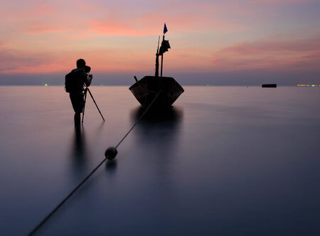 murk: Photographer is taking a photo of a fishing boat