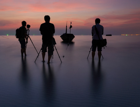 reflexive: Photographer is taking a photo of a fishing boat