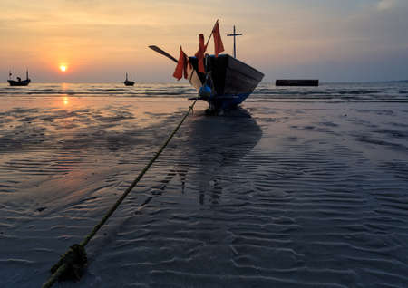 reflexive: The fishing boat stuck on sand beach , Thailand