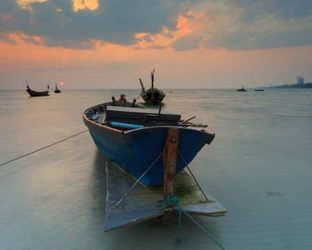 murk: The fishing boat with a beautiful sunset, Thailand