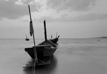 murk: The fishing boat with a beautiful sunset in black and white, Thailand