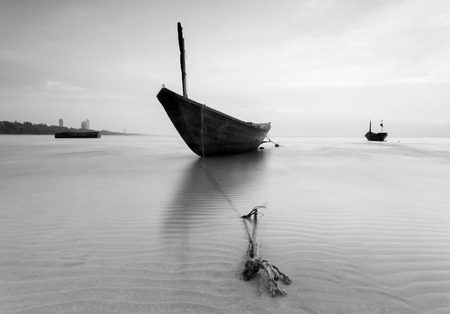 reflexive: The fishing boat in black and white at Kon Ao Beach, Rayong, Thailand Stock Photo