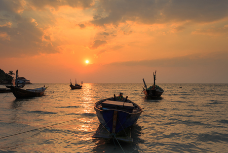 reflexive: The fishing boat with a beautiful sunset, Thailand