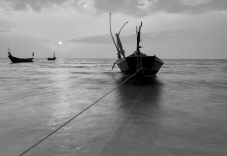 reflexive: The fishing boat with a beautiful sunset in black and white, Thailand
