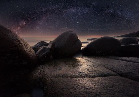 clearly: The stone beach under starry night clearly with milky way
