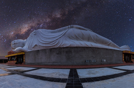 White reclining  buddha under starry night with clearly  milky way  , Thailand Stock Photo