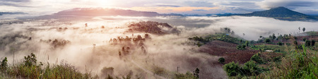 generic location: Thailand landscape panorama of the mountains in the mist at sunrise time. Nature panorama. Stock Photo