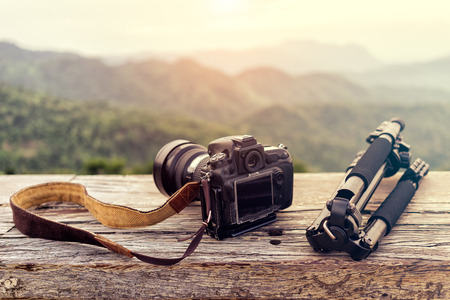 Travel photographer equipment with beautiful landscape on the background, Traveling and Relax Concept.