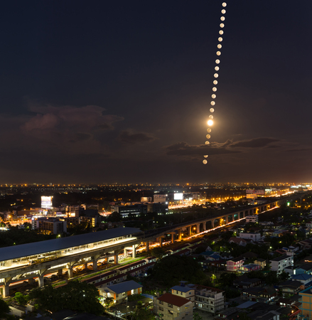 Moon Phases , moon trail over the city pf Bangkok, Thailand- Night Landscape with City.