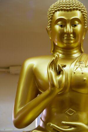 Focus thumb hand of Buddha photo