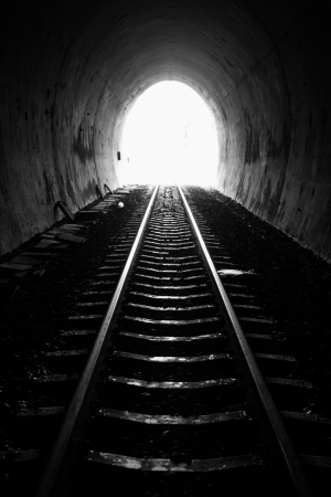 the end: Light at the end of railroad tunnel. Natural lighting Stock Photo