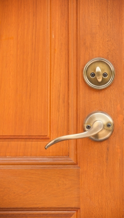 door lock: Modren style door handle on natural wooden door