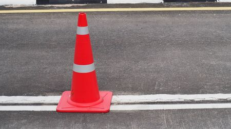 A red-orange traffic cone was placed on the road Stock Photo